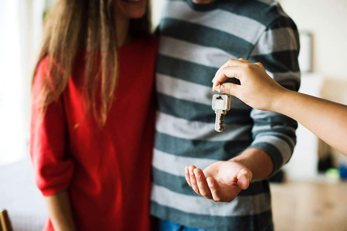 Couple being handed house keys